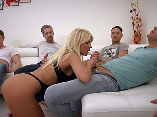 Big tittied slut Tiffany Rousso enjoys bukkake after hardcore blowbang scene