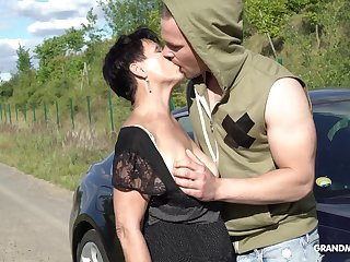 Insulting unexpected haired mature impenetrable stands on knees to give BJ outdoors