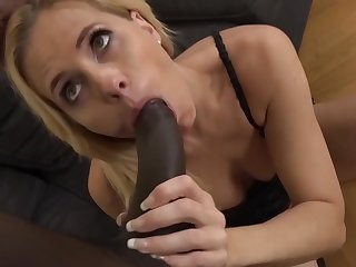 Matured blonde woman is sucking a big, black dick and getting it inside her pussy