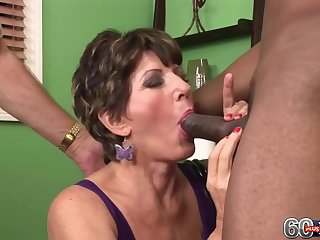 Mature lady is fucking a handsome, black chap in front of her husband, who likes to watch