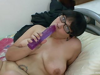 Chunky Asian girl in glasses toys more her big shaved pussy