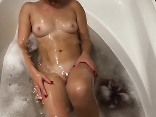 Having some fun time in bath with my sexy blond wife