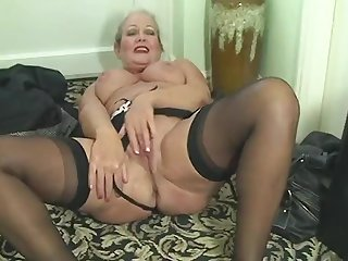 Granny April Undresses And Savorily Jerks Off Her Old Cunt