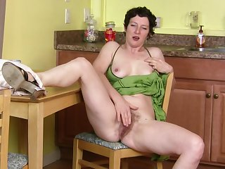 Calumnious mature slut Artemisia plays with her pussy in the kitchen